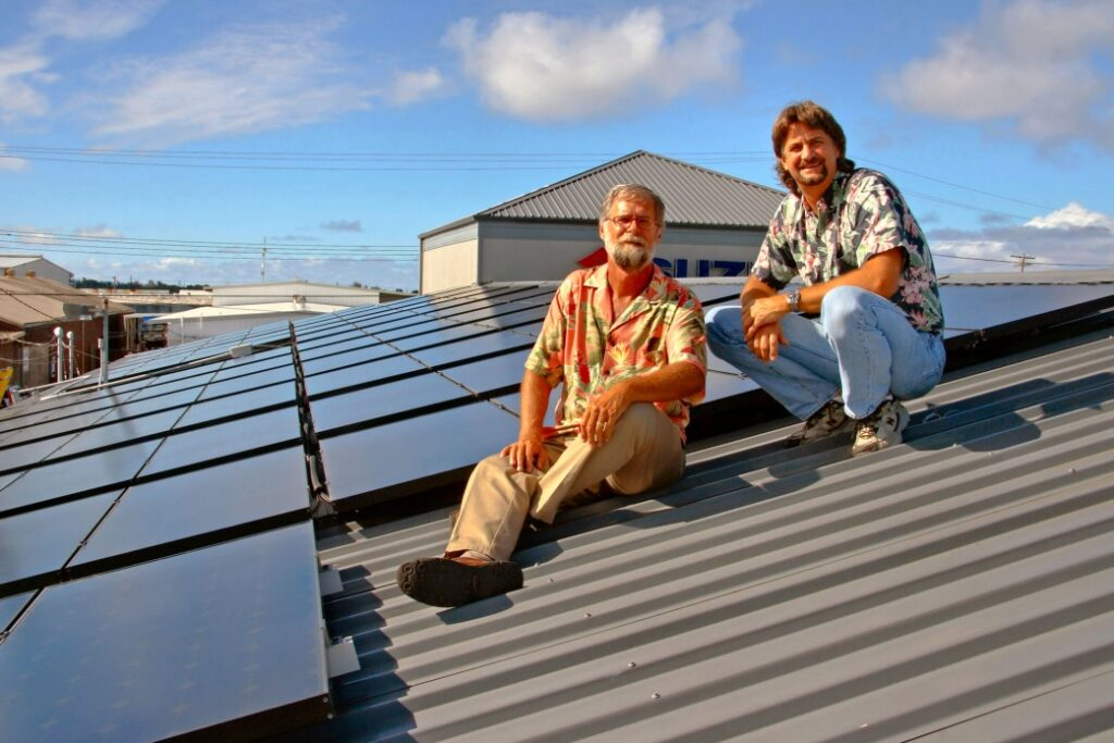 Marco & Doug on Hilo Ford dealership roof
